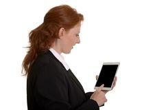 Pretty red-haired business woman with mini tablet pc Stock Photography