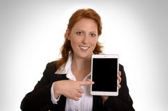 Pretty red-haired business woman with mini tablet pc Stock Image