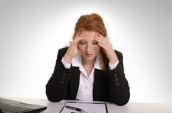 Pretty red-haired business woman suffering  burn out Stock Photos
