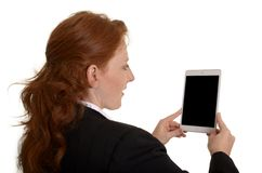Pretty red-haired business woman taking picture with mini tablet Stock Photography