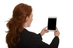 Pretty red-haired business woman taking picture with mini tablet Stock Photos
