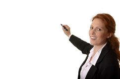 Pretty red-haired business woman writing with pen Royalty Free Stock Photography