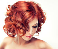Pretty red-haired girl Stock Image
