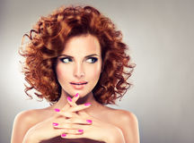 Pretty red haired girl with curls. Stock Photography