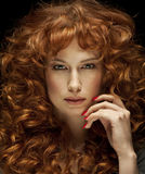 Pretty red-haired girl with curls. Frackles Stock Image