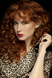 Pretty red-haired girl with curls, frackles. Fashion Girl Portrait Royalty Free Stock Photos