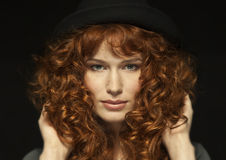 Pretty red-haired girl with curls, freckles Stock Photos