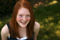 Pretty red haired girl with freckles Royalty Free Stock Photography