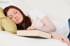 Pretty red-haired girl having  rest while studying Royalty Free Stock Photography