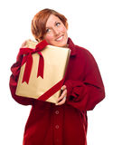 Pretty Red Haired Girl with Wrapped Gift Isolated Royalty Free Stock Photos