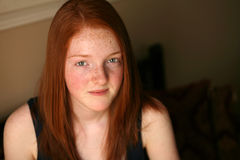 Pretty red haired preteen girl Stock Photography