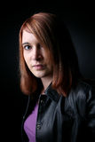 Pretty red haired teen in purple Stock Photography
