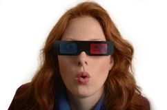 Pretty red-haired woman with 3D glasses Royalty Free Stock Photo