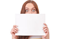 Pretty red-haired woman holding paper board Stock Photos