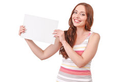 Pretty red-haired woman holding paper board Royalty Free Stock Image