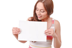 Pretty red-haired woman holding paper board Stock Photo