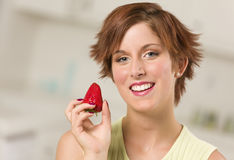 Pretty Red Haired Woman Holding Strawberry Stock Image