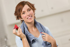 Pretty Red Haired Woman Holding Strawberry Stock Photo