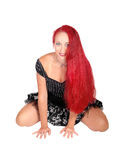 Pretty red haired woman kneeling. Royalty Free Stock Photography