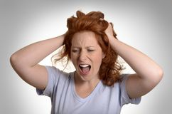 Pretty red-haired woman screaming Royalty Free Stock Photo