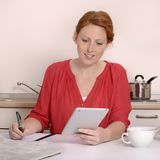 Pretty red-haired woman searching for job Stock Images