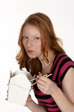 Pretty Red Head Slurping Chinese Noodles Royalty Free Stock Photography