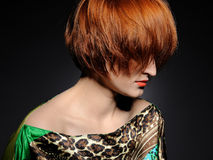Pretty red heaired woman with fashion hairstyle Royalty Free Stock Images