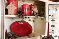 Pretty red pottery in open cupboard Royalty Free Stock Photo