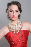 Pretty Red Themed Fashion Model Wearing Lots of Pearls Royalty Free Stock Photo