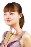 Pretty red woman with pink rose Royalty Free Stock Images