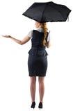 Pretty redhead businesswoman holding umbrella Stock Photography