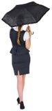 Pretty redhead businesswoman holding umbrella Stock Images