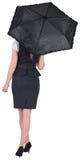 Pretty redhead businesswoman holding umbrella Royalty Free Stock Photo