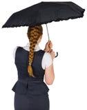Pretty redhead businesswoman holding umbrella Royalty Free Stock Photography