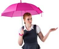 Pretty redhead businesswoman holding umbrella Royalty Free Stock Image