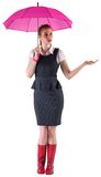 Pretty redhead businesswoman holding umbrella Royalty Free Stock Photos