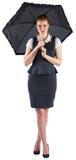 Pretty redhead businesswoman holding umbrella Stock Photos