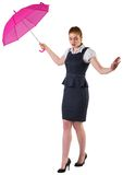 Pretty redhead businesswoman holding umbrella Stock Image