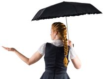 Pretty redhead businesswoman holding umbrella Stock Photo