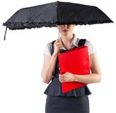 Pretty redhead businesswoman holding umbrella Stock Images