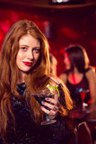 Pretty redhead drinking a cocktail Stock Images