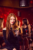 Pretty redhead drinking a cocktail Royalty Free Stock Photos