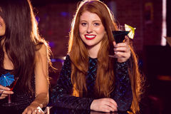 Pretty redhead drinking a cocktail Stock Image