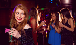 Pretty redhead drinking a cocktail Stock Photography