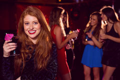 Pretty redhead drinking a cocktail Royalty Free Stock Photo