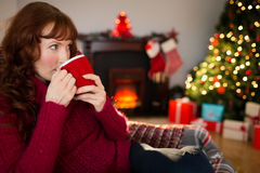 Pretty redhead drinking hot drink at christmas Royalty Free Stock Photo