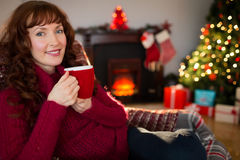Pretty redhead enjoying hot drink at christmas Stock Photography