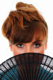 Pretty redhead girl with fan Royalty Free Stock Images