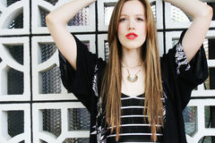 Pretty redhead girl with long hair. Pretty redhead girl in lipstick wearing black and white fashion Royalty Free Stock Image