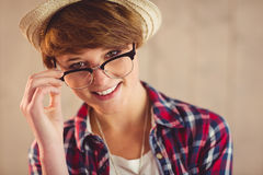 Pretty redhead holding her reading glasses Stock Image